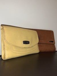 Two Fossil wallets