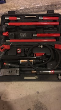 red-and-black handheld tool set in case