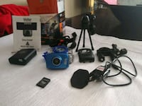 blue Vivitar action camera with accessories Laval, H7K 3V6
