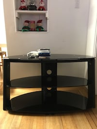 Black glass tv stand ,excellent condition