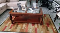 brown wooden framed glass top coffee table North Miami Beach