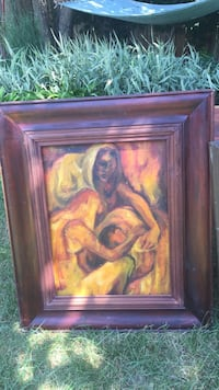 Brown wooden framed painting of woman Toronto, M8W 4K2