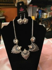 silver-colored chain necklace with pair of earrings