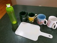 Cups, cutting board and a water bottle Manassas