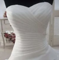 White sweetheart neckline strapless gown. Nothing wrong with it just bought the first one I tried on and am now realizing it's not the dress I want. Size 12