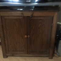 brown wooden 2-door cabinet Ocala, 34471