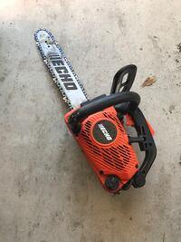 red and black Echo chainsaw