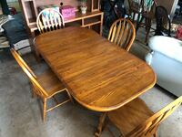oval brown wooden table with six chairs dining set Livingston Manor