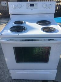 Whirlpool electric stove white,new pans and new cord,clean!