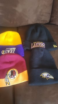 four assorted beanie hats