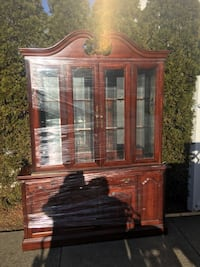 Brown wooden framed glass display cabinet. With touch lighting.