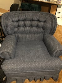 gray fabric padded sofa chair