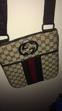 gray Gucci sling bag Fayetteville, 28314