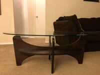 Brown wooden base glass top coffee table