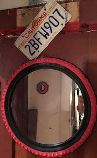 round wall mirror with red and black frame Vancouver, V5L 2Z7