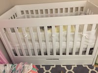 Baby's white wooden crib Including brand new premium mattress