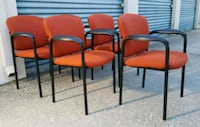 four red padded black metal chairs Orlando, 32811