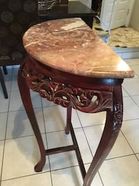 Brown wooden framed marble top side table