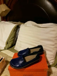 pair of blue leather loafers 229 mi