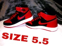 red-and-black Nike low-top sneakers San Benito, 78586