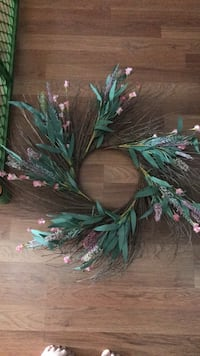 wreath with purple pink flowers and twigs