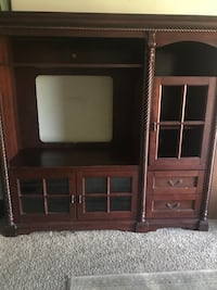 Brown wooden tv hutch with flat screen television Ontario, 91761