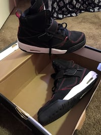 pair of black Air Jordan basketball shoes
