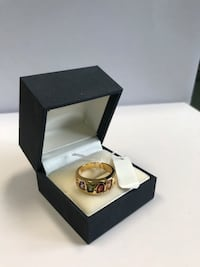 Golden ring with multi colour stone