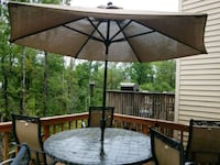 round black metal patio table with chairs set Clifton, 20124