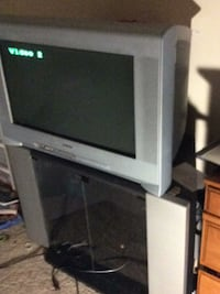 Television and stand heavy tv well help load works great Alexandria, 22306