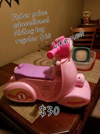 pink and white plastic toy 123 mi