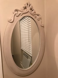 oblong white wood framed mirror