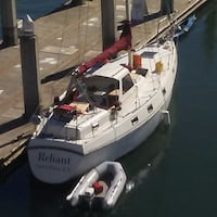 white Reliant boat and gray raft Oakland