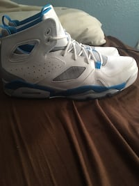 Pair of white air jordan basketball shoes Loveland, 80537