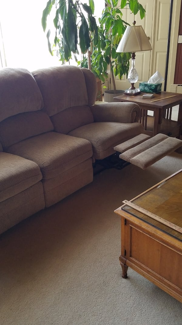 Couch. Very heavy. Reclining on left and right sides ddca3c14-f9ab-40e6-9113-d88d30a48877