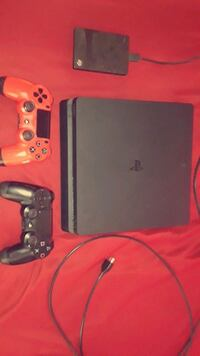 black Sony PS4 console with two controllers Albuquerque, 87121