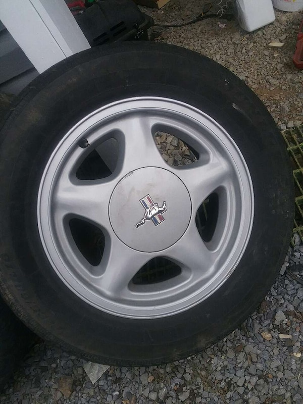Used Set 4 Mustang 4 lug wheels and tires missing 2 wheel