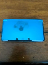 Nintendo 3DS (with charger, two games)