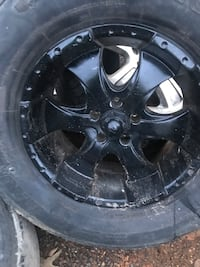 5 wheels and tires for a Jeep Cherokee