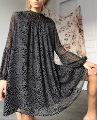 black polka dot mini dress with flying translucent sleeves.