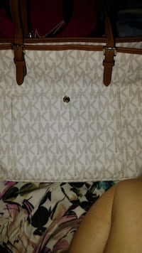 white and gray Michael Kors tote bag