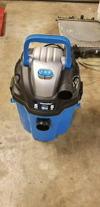 blue and black canister vacuum cleaner
