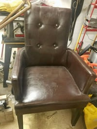 brown leather padded armchair with brown wooden frame Denver, 80231