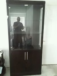 black wooden framed glass display cabinet