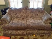 beige-and-brown fabric floral loveseat