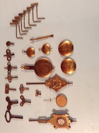 Assorted brass clock keys, pendulums, and wrenches Conyers, 30094