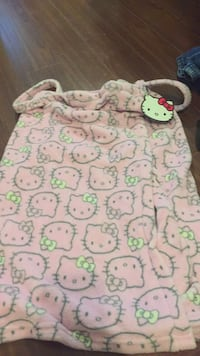 Size medium hello Kitty swim cover up or after shower cover up. Adorable and ew only $12. Vaughan, L4J 5M3