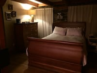 Brown wooden sleigh bed frame (mattress not included) Montreal, H2Y 2E2