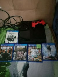 black Sony PS4 console with controller and game cases Winnipeg, R2W 0R9