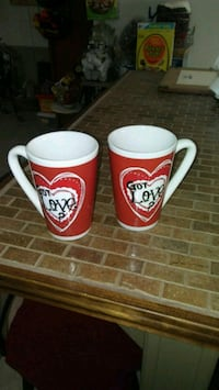 "Two ""got love"" mugs"